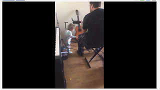 Baby girl rocks out to dad's guitar performance