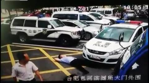 Bizarre moment man pretends to be hit by a police car