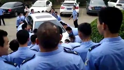 Students pick up car that was in the way of their graduation photo