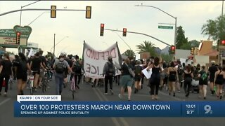 More than 100 people march near downtown Tucson