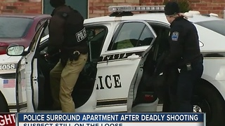 Police Surround Apartment After Deadly Shooting - Video