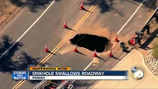 Sinkhole swallows roadway - Video