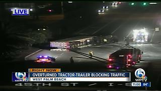 Ovrturned tractor-trailer blocking traffic - Video