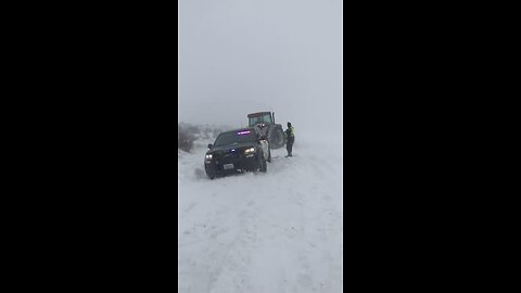 Tractor Frees Police Car Trapped in Washington Blizzard