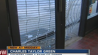 Armed robbery suspect crashes stolen truck into Green Country Arms & Pawn. - Video