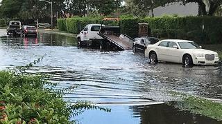 Who is responsible for flooded street? - Video