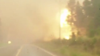 Locals Film Dramatic Escape as Fire Rages Along Roadside in British Columbia - Video