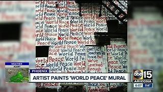 Mural artist painting for world peace - Video