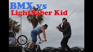 Epic Star Wars Themed Battle Between BMX Rider and Lightsaber Kid - Video