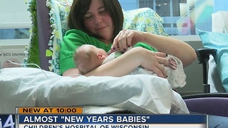Dozens of would-be New Year's babies welcomed early - Video