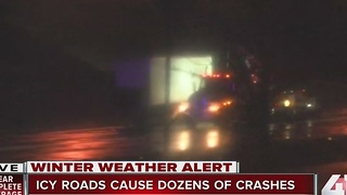 Ice-covered highways delay truck drivers - Video