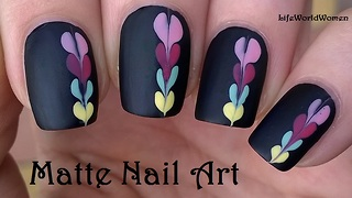 Matte black nail art idea with heart design - Video
