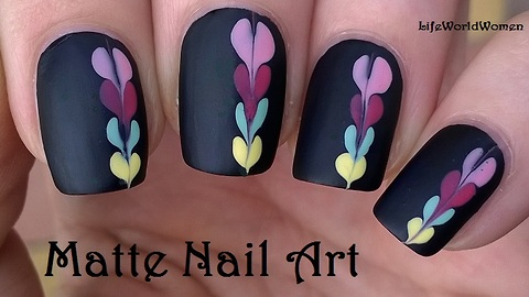 Matte black nail art idea with heart design