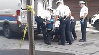 Police Lift Woman from Wheelchair into Van During Healthcare Protest - Video
