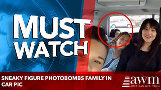 Sneaky Figure Photobombs Family in Car Pic - Video