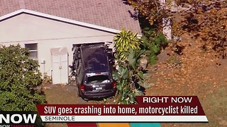 Crash involving vehicle, motorcycle and home in Seminole - Video