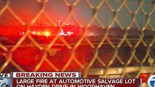 Large fire at automotive salvage lot in Woodhaven - Video