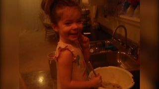Little Girl Adds A Special Ingredient Into Muffins