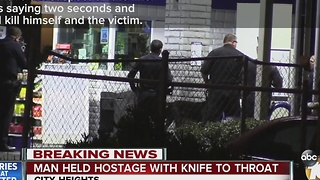 Man held hostage with knife to throat - Video