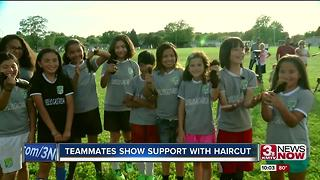 Teammates cut hair for Mili - Video
