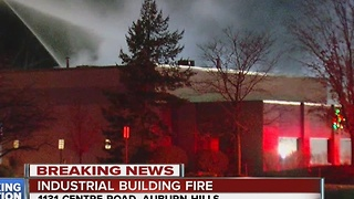 Crews battle building fire in Auburn Hills