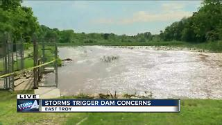 East Troy officials keeping close watch on a dam after heavy rain - Video