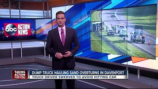 Sand truck overturns on highway in Davenport - Video