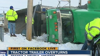 Tractor trailer rolls over in Amherst - Video