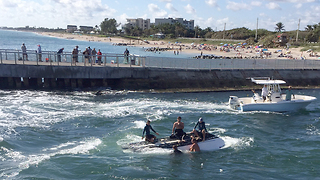 Five boaters rescued when boat capsizes - Video