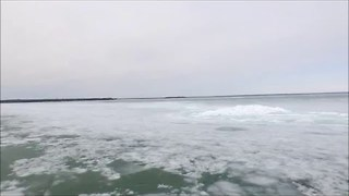 Drone Shows Stunning Footage of Blue Ice on Lake in Ontario, Canada - Video