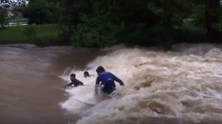 Thrill-seeking Surfers Dive Into Raging Floodwaters at Murwillumbah Weir - Video