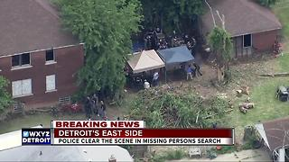 Police clear scene in missing persons search - Video