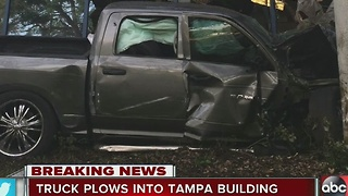 Truck plows into Tampa building - Video