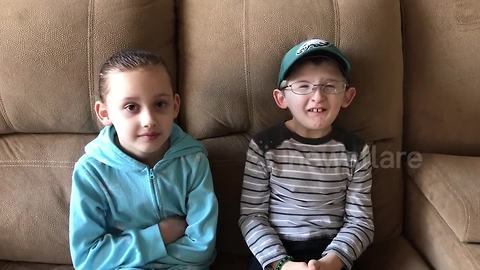 Boy with rare condition teaches sister to spell his football team's name