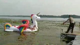 Cops pull bikini clad women stranded on inflatable unicorn to safety