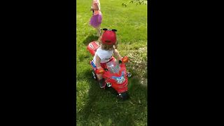 Boy, 2, crashes toy motorbike while looking at girl - Video