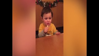 Baby Makes Cute Faces when Eating a Lemon