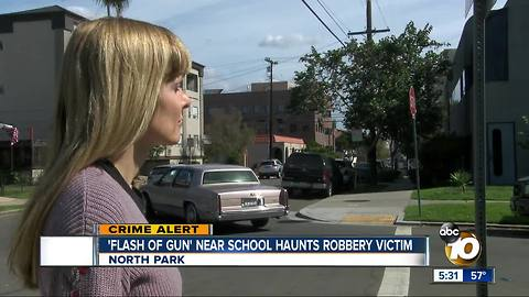 Flash of gun near school haunts a robbery victim