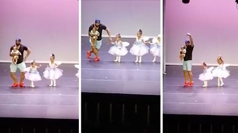 Who said men can't multi-task? Dexterous dad jumps on stage to perform with stage-fright-stricken daughter in dainty ballet routine while clutching another child
