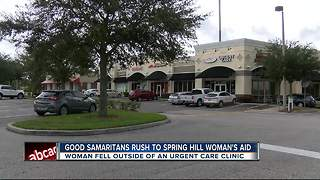 Good Samaritans rush to Spring Hill woman's aid after she fell outside an urgent care clinic. - Video