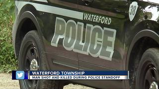 Man shot and killed during police standoff in Waterford Township - Video