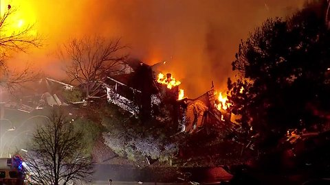 Neighbors report hearing explosion before large fire burning at Heather Gardens in Aurora