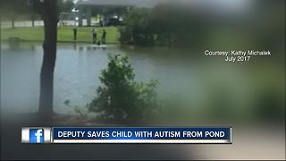 Deputy saves child with Autism from pond - Video