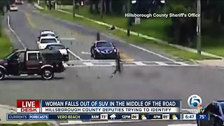 Police seek woman after video shows her falling out of SUV in Florida - Video