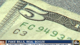 Man arrested for passing counterfeit $5 bills at liquor store - Video