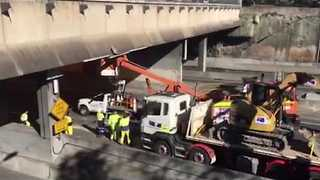 Truck Carrying a Bulldozer Hits Sydney Overpass - Video