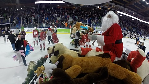 Santa gathers up teddy bears for orphans with Zamboni