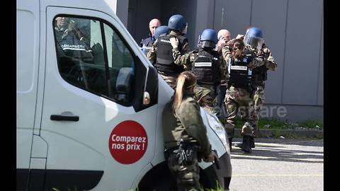 Photographer's images capture police raid during hostage situation in France