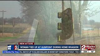 Woman tied up at gunpoint in home invasion - Video