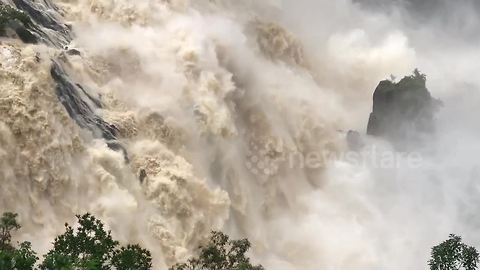 Flooded Barron Falls gushes after heavy rainfall in Queensland